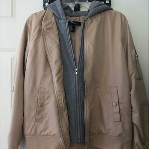 tan hoodie is attached inside bomber jacket